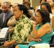 Andrew Young's wife Carolyn and Humanities Council of D.C.'s Executive Director Joy Ford Austin listen as Young explains his experiences as Ambassador.  The event was arranged, in part, because of the longtime friendship between Carolyn and Austin.